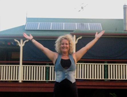Samford resident Ady Hopkins in front of her solar panelled house.